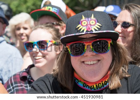 TORONTO,CANADA-JULY 3,2016: Pride Month: multicultural Toronto people enjoying and supporting the gay community during Pride Parade.  It is the first ever Pride Month celebrated in Toronto
