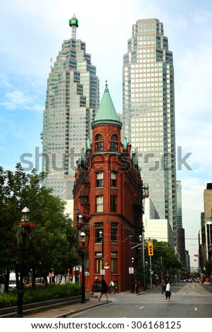 TORONTO CANADA JULY 10, 2015The red-brick Gooderham Building is a historic landmark of Toronto, Ontario, Canada and is the focal point of one of Toronto's most iconic vistas. - stock photo
