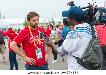TORONTO,CANADA-JULY 8,2015: TORONTO,CANADA-JULY 8,2015: Mark Oldershaw: Canadian delegation arrived to the PanAm 2015 Athlete's Village in Toronto .Credentials available - stock photo