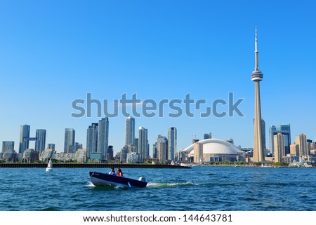 TORONTO, CANADA - JULY 3: Toronto skyline with boat on July 3, 2012 in Toronto, Canada. Toronto with the population of 6M is the provincial capital of Ontario and the largest city in Canada.