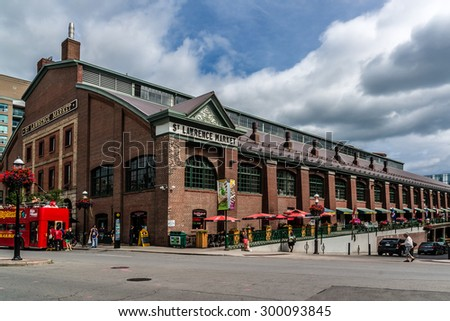 TORONTO, CANADA - JULY 23, 2014: View of St Lawrence Market in central Toronto. This massive 19th century brick building is home to the cityâ??s largest market. - stock photo