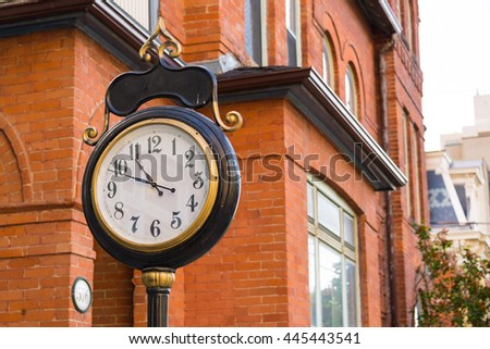 TORONTO,CANADA-JUNE 16,2016:Functional vintage Victorian street clock in downtown. The city is know for its mixture of attractive architecture for visitors and tourists. - stock photo