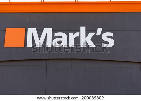 TORONTO,CANADA-JUNE 21, 2014: Mark's Work Wearhouse is a Canadian clothing retailer which sells work clothes for labour-oriented jobs and expanded its selection to include business casual clothing.