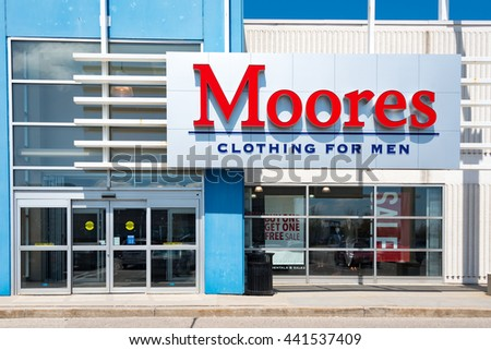 TORONTO,CANADA-JUNE 10,2016:Moores Clothing for Men store sign at entrance: Moores is a Canadian brand specialized in tailor-made clothing for men similar to Tip Top Tailors.