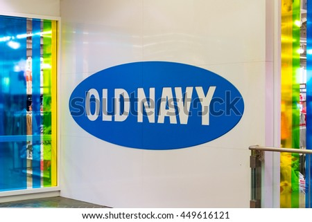 TORONTO,CANADA-JUNE 24,2016: Old Navy blue logo printed on wall. Old Navy is an American clothing and accessories retailer owned by American multinational corporation, Gap.