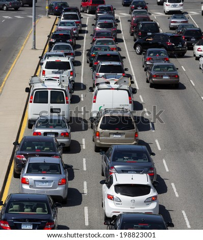 TORONTO, CANADA - JUNE 6 2014: Queue of Traffic on a road in central Toronto during the day