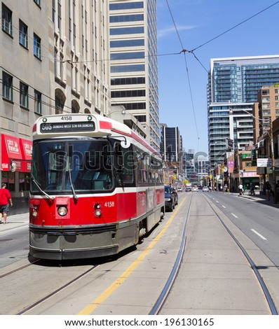 TORONTO, CANADA - JUNE 1, 2014: The front of a Street Car on a road in Toronto