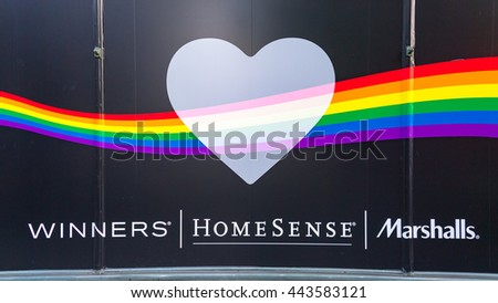 TORONTO,CANADA-JUNE 20,2016:Winners, Homesense and Marshalls celebrate Pride Month with a rainbow flag design in a store wall. Toronto celebrates along with the gay community the first Pride Month - stock photo