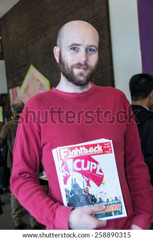 TORONTO,CANADA-MARCH 8,2015:Alex Grant leader of Communist group. Thousands gathered in Toronto to mark International Women Day IWD with a protest march demanding improvements in many social issues. - stock photo