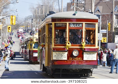 TORONTO,CANADA-MARCH 27,2016: Beaches Lions Club Easter Parade: Vintage TTC streetcars. The parade celebrates 50th anniversary in the Queen Street East during Easter Sunday - stock photo