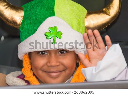 TORONTO,CANADA-MARCH 15,2015:Child wearing a leprechaun hat during the St. Patrick's Day Parade 28th edition which is the fourth largest celebration of its kind in the world. - stock photo