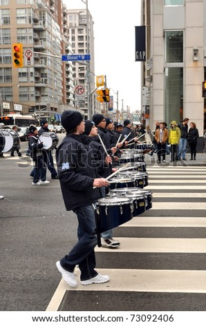 TORONTO, CANADA - MARCH 13: Precision drum band marches in unison as part of the St. Patrick's Day Parade March 13, 2011 in Toronto, Ontario.