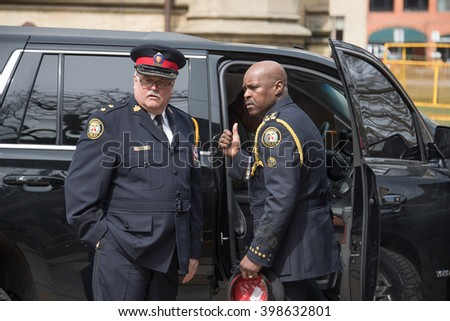 TORONTO,CANADA-MARCH 30,2016: Rob Ford, former Toronto Mayor, funeral scenes. The procession walked from the City Hall to the St. James Cathedral where the final good bye ceremony was held.