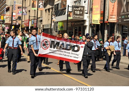 TORONTO, CANADA - MARCH 11:  Supporters of Mothers Against Drunk Driving march in the annual St Patrick's Day Parade, March 11, 2012 in Toronto, Ontario. - stock photo