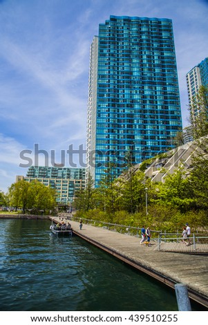 TORONTO, CANADA - MAY 25, 2015 : Buildings on the shore of Lake Ontario nears Queen's Quay in Toronto