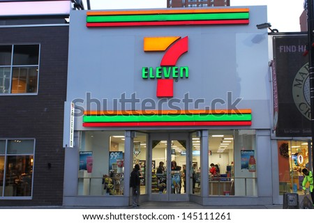 TORONTO, CANADA - MAY 25: 7-Eleven convenience store on May 25, 2013 in downtown Toronto, Ontario, Canada. 7-Eleven is the world's largest operator, licensor and franchisor of convenience stores. - stock photo