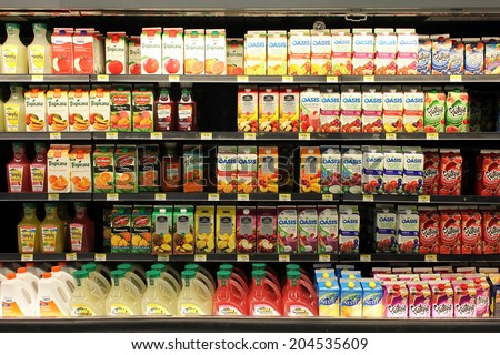TORONTO, CANADA - MAY 26, 2014: Fruit juices on shelves in a supermarket. Fruit juice consumption overall in Europe, Australia, New Zealand and the US has increased in recent years. - stock photo