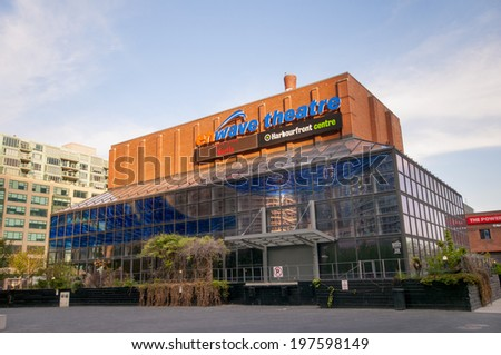 TORONTO, CANADA - MAY 31, 2014: Harbourfront Centre entrance, the heart of Toronto�¢??s waterfront, features two forest-inspired squares and an outdoor exhibition and marketplace. - stock photo