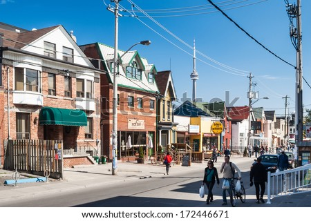 TORONTO, CANADA - MAY 2, 2007: Houses on College Street West, a district in Toronto, Ontario, also known as Little Italy, renowned for its numerous Italian Canadian restaurants and businesses. - stock photo