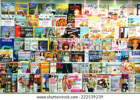 TORONTO, CANADA - MAY 07, 2014: Magazines on display in a store in Toronto, Ontario, Canada. There are more than 1300  English and French magazines that are published in Canada. - stock photo