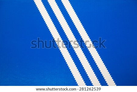 TORONTO,CANADA-MAY 2,2015: Old Adidas logo consisting in three white