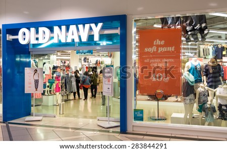 TORONTO,CANADA-MAY 25,2015: Old Navy clothing store draws a crowd to its latest sale.Old Navy is a popular clothing and accessories retailer owned by American multinational corporation Gap Inc. - stock photo