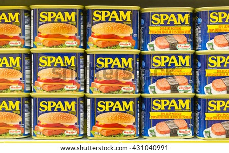 TORONTO,CANADA-MAY 26,2016: Spam canned meat stacked vertically in store shelf.  Spam is a brand of canned precooked meat products made by Hormel Foods Corporation.