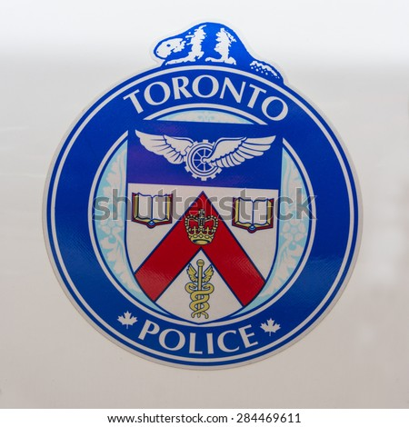 TORONTO,CANADA-MAY 17,2015: The Toronto Police Service was established in 1834, it was the first municipal police in North America and one of the oldest police services in the English-speaking world. - stock photo