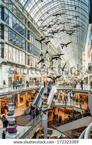 TORONTO, CANADA - MAY 4, 2007: Toronto Eaton Center is shopping centre and office complex in downtown Toronto. The sculpture of birds was designed by artist Michael Snow. - stock photo