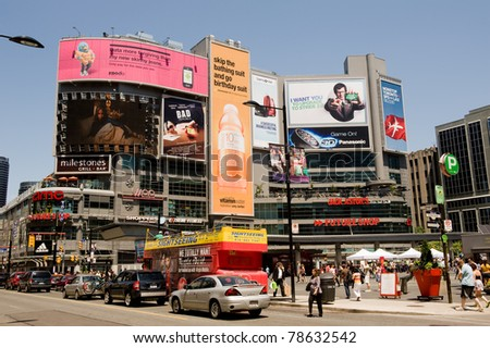 TORONTO, CANADA - MAY 6: Yonge-Dundas Square in Toronto May 6, 2011.  A public square modeled after Times Square attracts thousands of tourists and locals daily, it often has live entertainment. - stock photo