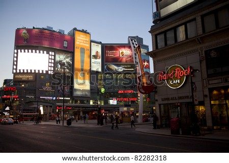 TORONTO, CANADA - MAY 5: Yonge-Dundas Square in Toronto May 5, 2011. A public square modeled after Times Square attracts thousands of tourists and locals daily, it often has live entertainment. - stock photo
