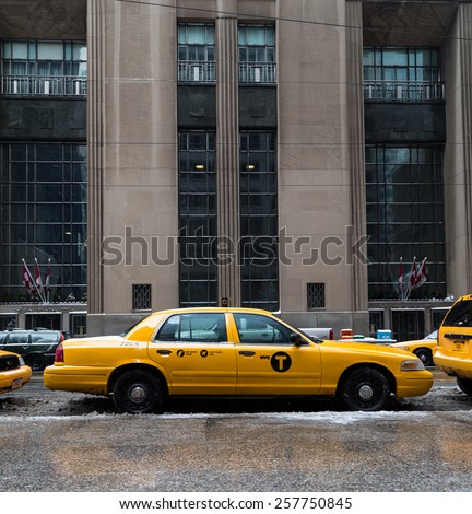 TORONTO, CANADA - 22ND FEBRUARY 2015: A New York City Taxi in downtown Toronto during the day. - stock photo