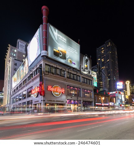 TORONTO, CANADA - 22ND JANUARY 2015: Part of Yonge Street in downtown Toronto at night showing some bars, shops and restaurants.