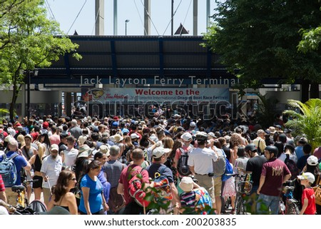 TORONTO, CANADA - 22ND JUNE 2014: View outside the Jack Layton Ferry Terminal showing large amounts of people queuing for the boats - stock photo