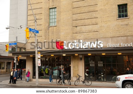 TORONTO, CANADA - NOV 30:  Historic Maple Leaf Gardens, closed since 1999, was reopened to the public as a retail center including a Loblaws store after a long renovation 0n Nov 30, 2011 in Toronto, Canada. - stock photo