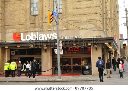 TORONTO, CANADA - NOV 30: Historic Maple Leaf Gardens, closed since 1999, was reopened to the public as a retail center including a Loblaws store after a long renovation on Nov 30, 2011 in Toronto, Canada. - stock photo