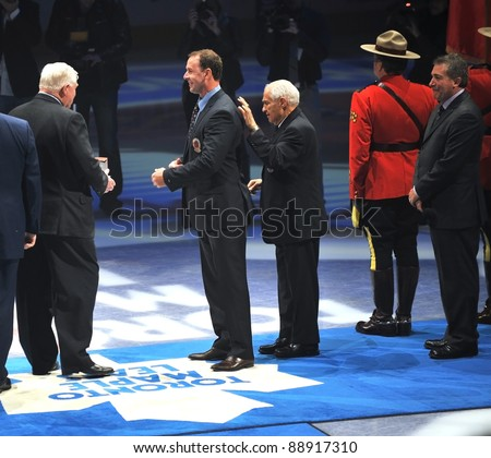 TORONTO, CANADA - NOV 13:  Joe Nieuwendyk is given his Hall of Fame blazer before the Hockey Hall of Fame Legends Classic game on Nov 13, 2011 Air Canada Centre in Toronto, Canada. - stock photo