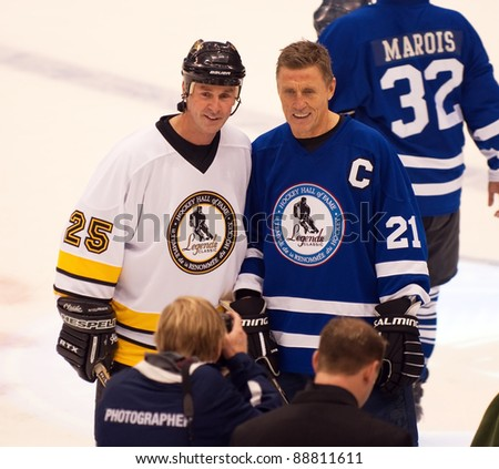 TORONTO, CANADA - NOV 13:  New inductee Joe Nieuwendyk (L)  poses with team captain Borje Salming after the Hockey Hall of Fame Legends Classic game on Nov 13, 2011 at the Air Canada Centre in Toronto, Canada. - stock photo