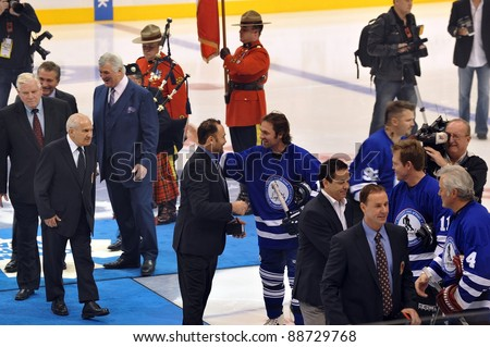 TORONTO, CANADA – NOV 13: Recent HHOF inductees are congratulated by other former NHL players at the Hockey Hall of Fame Legends Classic game on Nov 13, 2011 in Toronto, Canada. - stock photo