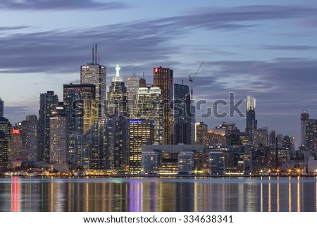 TORONTO, CANADA - NOVEMBER 02, 2015: Downtown Toronto skyline with  the Financial District skyscrapers and the adjacent high-rise buildings, illuminated after sunset . - stock photo