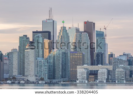 TORONTO, CANADA - NOVEMBER 02, 2015:  Downtown Toronto skyline with the Financial District skyscrapers and the adjacent high-rise buildings at sunset  - stock photo