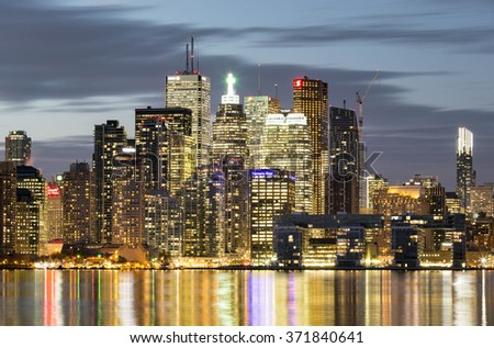 TORONTO, CANADA - NOVEMBER 02, 2015:  Downtown Toronto skyline with the Financial District skyscrapers and the adjacent high-rise buildings illuminated at night - stock photo