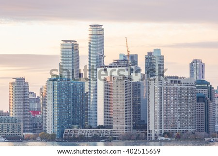 TORONTO, CANADA - NOVEMBER 2, 2015:  High-rise buildings  and skyscrapers line the waterfront of Toronto Harbour - stock photo
