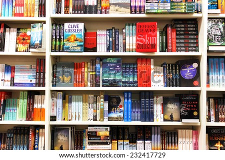 TORONTO, CANADA - NOVEMBER 8, 2014: Novels and fiction on display in an Indigo bookstore. Indigo Books and Music Inc is one of the major Canadian retail bookstore chains. - stock photo