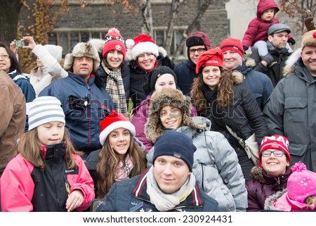 Toronto,Canada-November 16, 2014: Santa Claus parade held annually in mid-November. More than a half million people attend the parade every year. The televised parade starts after noon   - stock photo