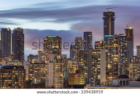 TORONTO, CANADA - NOVEMBER 14, 2015: Skyscrapers and new high-rise building sites in Downtown Toronto on a cloudy background, after sunset. - stock photo