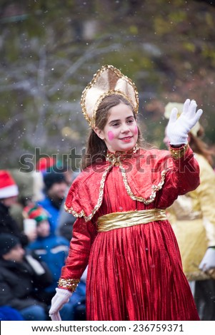TORONTO,CANADA-NOVEMBER 16,2014: The Toronto Santa Claus Parade is held annually in mid-November. More than a half million people attend every year. The televised parade starts after noon  - stock photo