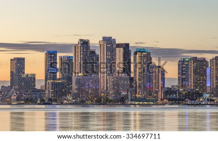 TORONTO, CANADA - NOVEMBER 02, 2015: View of  Toronto Harbourfront  district skyline with the adjacent high-rise condo buildings - illuminated during sunset .
