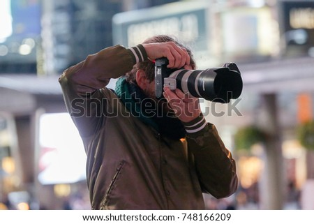 TORONTO, CANADA - OCTOBER 28, 2018: PHOTOGRAPHER NICK MERZETTI SHOOTS AN EVENT AT YONGE DUNDAS SQUARE.