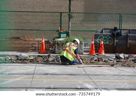 Toronto, CANADA - October 16, 2017: Queen Street West Under Construction, TTC Streetcar Repairs, Construction Workers In Uniform And Industrial Machinery Causing Traffic and Road Closures